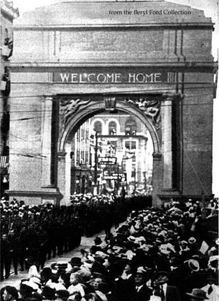 Tulsa honored Company D, 11th Engineers, 36th Division when they returned home on June 12, 1919 with the Arch of Welcome. The arch, made of paper mache, was erected on Main Street between 3rd & 4th Streets and was built at a price of $3500 and paid by public subscriptions.
